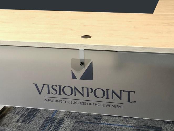 custom visionpoint logo on rev.247 desk